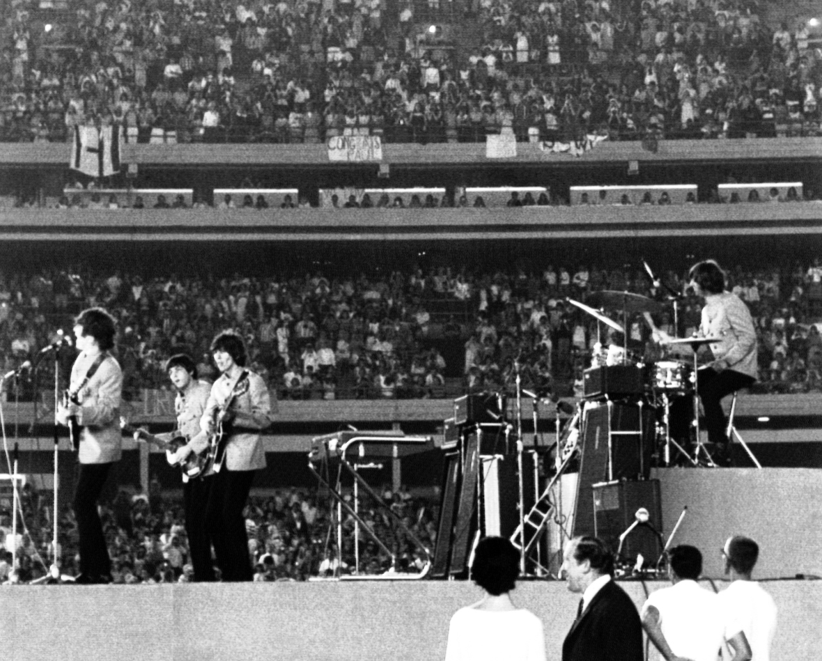 The Beatles performing at New York's Shea Stadium on Sunday, August 16, 1965, as some 50,000 fans cheer them on. L-R: John Lennon, Paul McCartney, George Harrison and Ringo Starr. (AP Photo)